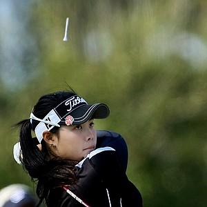 A tee goes flying above Moriya Jutanugarn's head after she tees off at No. 2. Jutanugarn place third.