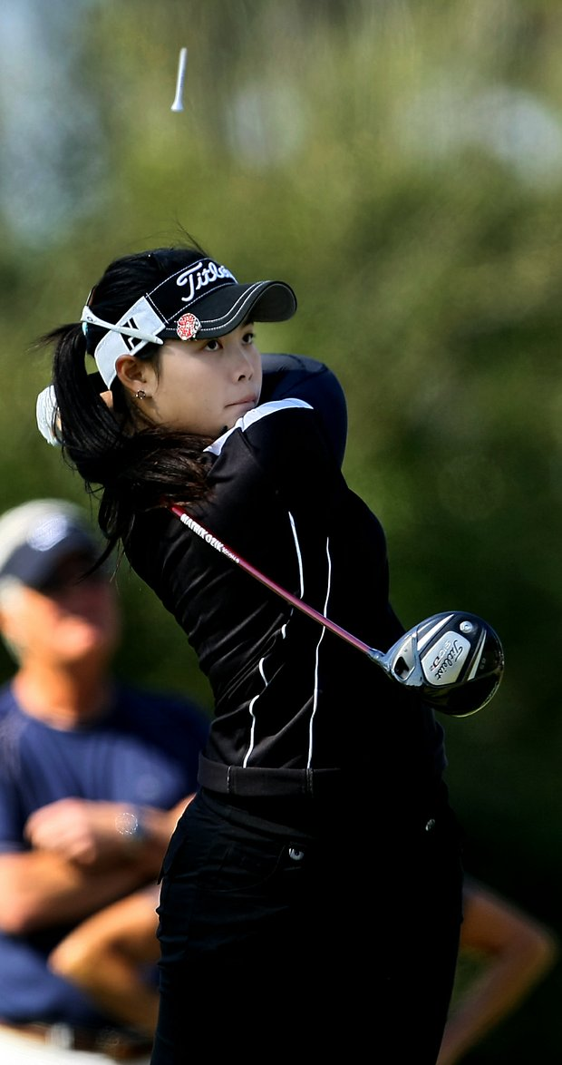 A tee goes flying above Moriya Jutanugarn's head after she tees off at No. 2. Jutanugarn place third.