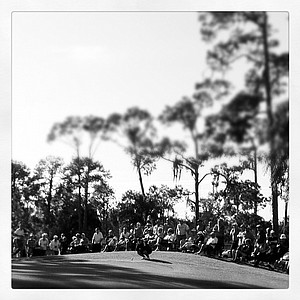 A large crowd watches at No. 9 as the final group makes the turn during the 57th Harder Hall Women's Invitational.