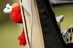 A Sesame Street Elmo head cover hangs on during the first round of the 86th South Atlantic Amateur.