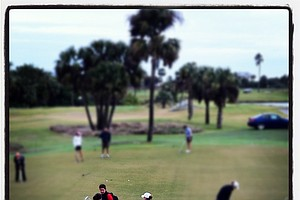 Holly Clyburn, bottom center, on the practice green during the first round of the 86th South Atlantic Amateur.