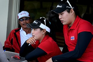 Ariya and Moriya Jutanugarn with their father after Thursday's round.  The girls are in first and third place after the second round.