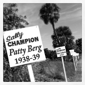 Signs of past champions greet players as they drive into Oceanside Country Club.
