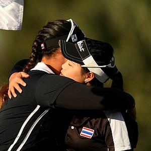 Moriya Jutanugarn gets a hug from her sister Ariya after winning the 86th South Atlantic Amateur at Oceanside Country Club. Ariya came in second.