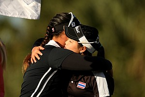 Moriya Jutanugarn gets a hug from her sister Ariya after winning the 86th South Atlantic Amateur at Oceanside Country Club. Ariya came in second.