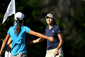 Alison Lee gets a hug from her playing partners after winning the 2012 Annika Invitational.
