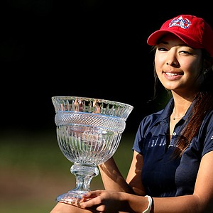 Alison Lee poses with the trophy after winning the 2012 Annika Invitational at Reunion Resort with a score of 213.