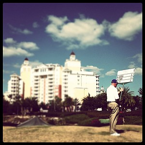 A sign bearer at No. 9 during the final round of the Annika Invitational at Reunion Resort.