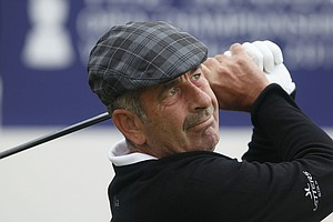 Sam Torrance of Scotland in action during the first round of the Senior Open Championship played at Walton Heath Golf Club on July 21, 2011 in Tadworth, England.