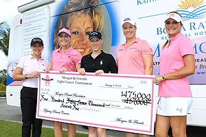 LPGA players, from left, Cristie Kerr, Paula Creamer, Morgan Pressel, Brittany Lincicome and Lexi Thompson pose with a benefit check during the Morgan and Friends Fight Cancer event at the St. Andrews Country Club in Boca Raton, Florida.