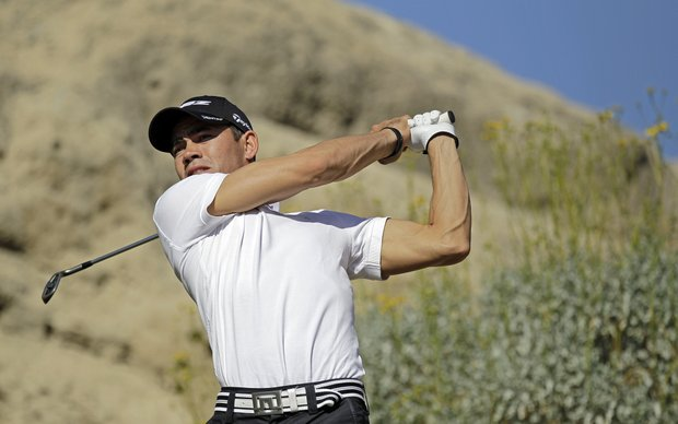 Camilo Villegas hits off the third tee during the first round of the Humana Challenge.