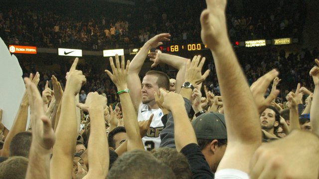 Knights fans lift captain A.J. Rompza as they mob the court after Knights beat Memphis 68-67 on Jan. 18.