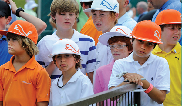 Young Rickie Fowler fans patiently wait for an autograph near the clubhouse during the second round of THE PLAYERS Championship on THE PLAYERS Stadium Course at TPC Sawgrass on May 13, 2011 in Ponte Vedra Beach, Florida. (Photo by Stan Badz/PGA TOUR)