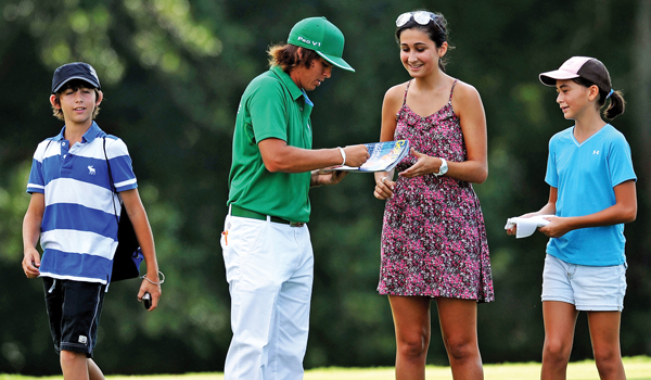 Rickie Fowler signs his autograph for a fan during a practice round prior to the start of the 93rd PGA Championship at the Atlanta Athletic Club on August 9, 2011 in Johns Creek, Georgia.