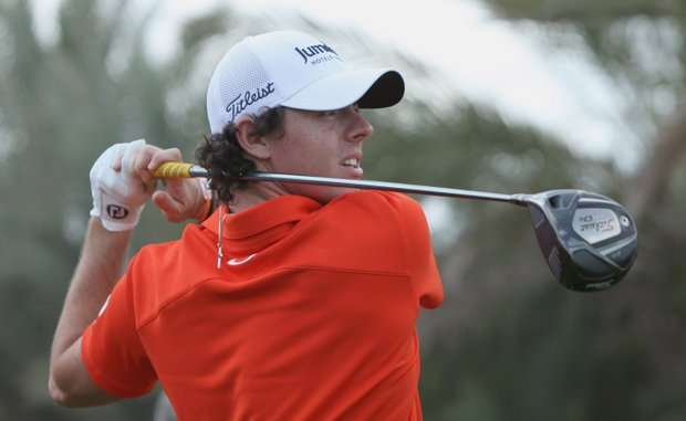 Rory McIlroy will be paired with Tiger Woods and Luke Donald in the opening round at Abu Dhabi.