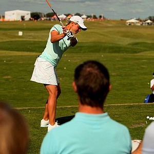 LPGA player Suzann Pettersen hits a hybrid in front of the Nike tent as Demo Day crowds gather.