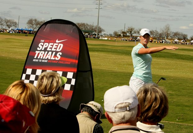 LPGA player Suzann Pettersen talks to the crowd between hybrid shots at the Nike tent.