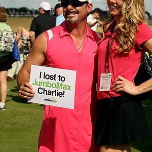 John Mazzanoble of JumboMax grips poses for pictures with a fan at Demo Day. Mazzanoble donned the pink dress that's featured in the popular JumboMax commercial.