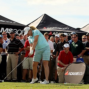 LPGA player Brittany Lincicome hits drivers at the Adams Golf tent during Demo Day.