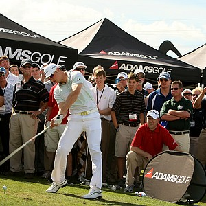Long drive champion Jamie Sadlowski hits driver in front of the Adams Golf tent for a large Demo Day crowd.