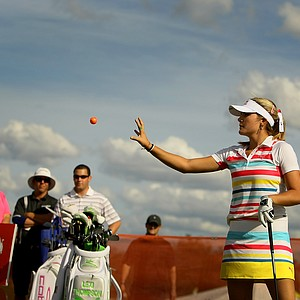 Lexi Thompson calls for another range ball during a driver session on the range at Demo Day. Thompson spent the afternoon at the Cobra Puma tent.