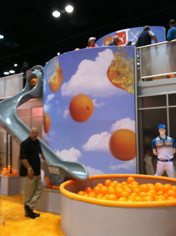 View of the slide in the Cobra/Puma booth at the PGA Merchandise Show.