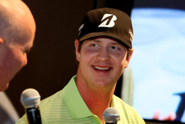 Hudson Swafford at the Bridgestone Golf booth during the first day of the 2012 PGA Merchandise Show.