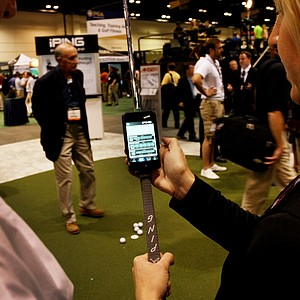 Ping has developed a putter app for smartphones, called iPing, that analyzes a player's stroke and suggests which putter fits that stroke. The phone rests in a cradle on the shaft during the stroke. Ping's Jenn Sun helps Patrick Aldrich of Sharon Country Club in Sharon, Conn., with the iPing putter app.