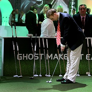 James Burns of Shelton, Conn., tries out a Ghost putter at the TaylorMade exhibition during the first day of the PGA Merchandise Show.