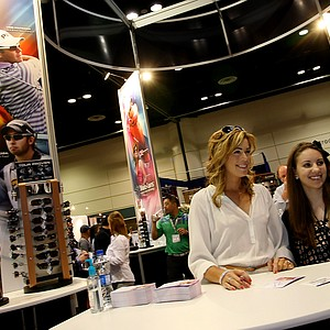 LPGA golfer Paula Creamer poses at the Sundog eyewear booth with Stephanie Yocu, of Charlotte, N.C., at the 2012 PGA Merchandise Show.