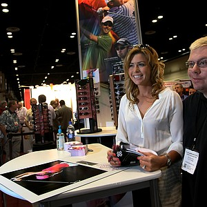 LPGA's Paula Creamer poses with Brian Strohmaier at the Sundog eyewear booth at the 2012 PGA Merchandise Show.