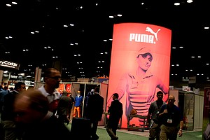 A picture of LPGA golfer Lexi Thompson graces the Cobra/Puma booth at the 2012 PGA Merchandise Show.