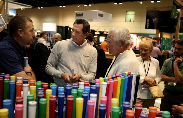 Hank Haney, center, with his childhood instructor, Hubby Habjan (right) talk with Wes Brasher, founder and CEO of PURE Grips at the 2012 PGA Merchandise Show