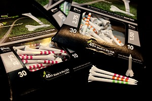 A sample of 2.75-inch tees and a 1.5-inch tees with Evolve Golf at the 2012 PGA Merchandise Show.