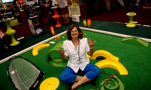Mary Anne Penton with Starting Time distributors of My Mini Golf at the 2012 PGA Merchandise Show.