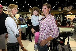 LPGA golfers, Maria Hjorth with her daughter Emily McBride and LPGA golfer Ryan O'Toole chat at the 2012 PGA Merchandise Show.
