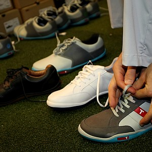 A sampling of True Linkswear shoes at at the 2012 PGA Merchandise Show. In the foreground are the True phx model.