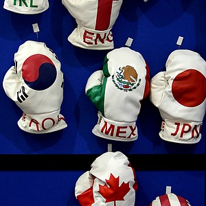 A variety of boxing glove head covers at AB Golf Designs at the 2012 PGA Merchandise Show.
