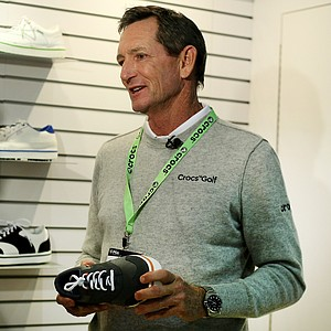 Instructor Hank Haney makes an appearance at Crocs at the 2012 PGA Merchandise Show.