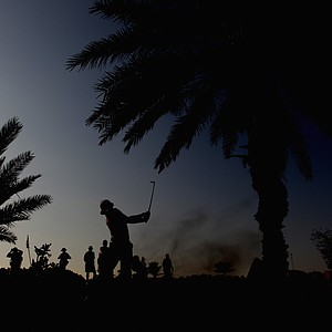 Rory McIlroy plays his second shot on the 18th hole during the third round of Abu Dhabi HSBC Golf Championship.