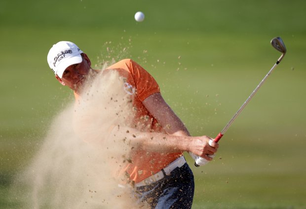 Robert Karlsson plays from a bunker during the third round of Abu Dhabi HSBC Golf Championship.