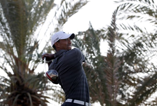Tiger Woods fired a 6-under 66 on Saturday to move into a share of the 54-hold lead at the Abu Dhabi Championship.