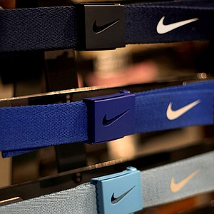 The Nike Tech Essentials web belt being shown on the floor as well during the final day at the 2012 PGA Merchandise Show is available in 17 colors. The buckle also is a bottle opener.