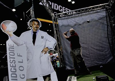 John Gardner from The Villages in central Florida hits balls at one of the Bridgestone ball fitting stations during the final day at the 2012 PGA Merchandise Show. David Feherty is a spokesperson for Bridgestone.