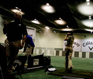Garrison Burr of Jacksonville, Fla., hits balls at the Callaway hitting bay during the final day at the 2012 PGA Merchandise Show.