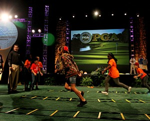 David Donatucci, director of fitness for PGA of America, leads the Boys and Girls Club of Central Florida through some exercises during the final day at the 2012 PGA Merchandise Show.