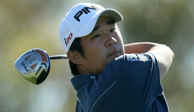 John Huh hits his tee shot on the 18th hole during the third round of the Farmers Insurance Open.