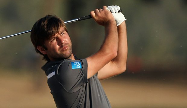 Robert Rock of England plays his second shot on the 16th hole during the third round of the Abu Dhabi HSBC Championship.