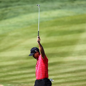 Tiger Woods reacts to his long birdie that he made on the 2nd hole during the final round of the Abu Dhabi Golf Championship.