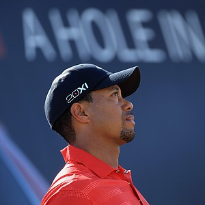 Tiger Woods waits on the seventh tee during the final round of the Abu Dhabi HSBC Golf Championship.